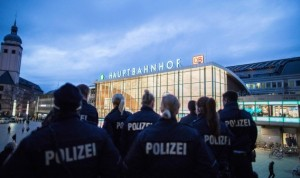 Police officers survey the area in front of the main train station and the Cathedral in Cologne, western Germany, on January 6, 2016, where dozens of apparently coordinated sexual assaults were perpetred against women on New Year's Eve.  / AFP / dpa / Maja Hitij / Germany OUT        (Photo credit should read MAJA HITIJ/AFP/Getty Images)