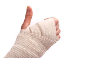 White medicine bandage on human injury hand. Studio isolated.