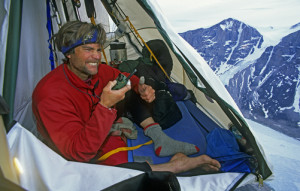 Alex Lowe in a portaledge camp high on a wall on Great Sail Peak.