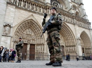 Soldiers patrol in front of the Notre Dame Cathedral in Paris, France, November 16, 2015. REUTERS/Charles Platiau/File Photo