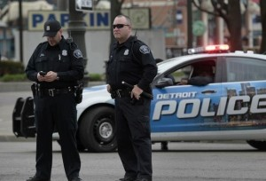 Detroit Police Officers stand along Woodward Avenue during a May Day protest against the Detroit Emergency Manager and the municipal Bankruptcy in downtown Detroit, Michigan May 1, 2014.    REUTERS/Rebecca Cook