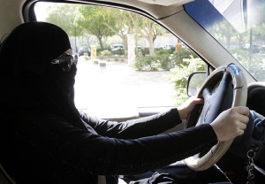 """epa03928059 A Saudi woman sits behind the wheel of a car in Riyadh, Saudi Arabia, 28 October 2013. Media reports on 27 October state that Saudi authorities arrested 14 women for driving in the conservative kingdom. The women were detained in the capital Riyadh, the western cities of Jeddah and Mecca as well as the Eastern Province. Activists have published more than a dozen videos on YouTube showing women driving in defiance of the decades-long """"ban,"""" which makes the oil-producing kingdom the world's only country where women are not allowed to drive.  EPA/STR"""