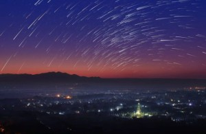 Beautiful scenery during the twilight before the sun rise and star trail of top view at Mandalay hill in Myanmar. is a beautiful location and very popular for tourists and photographer
