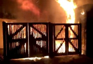 London Zoo is seen on fire, in London, Britain December 23, 2017 in this image taken from video footage obtained from social media. Brendan Cooney/via REUTERS THIS IMAGE HAS BEEN SUPPLIED BY A THIRD PARTY. MANDATORY CREDIT. NO RESALES. NO ARCHIVES. MUST ON SCREEN COURTESY BRENDAN COONEY