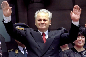 "Former Yugoslav president Slobodan Milosevic waves to supporters, as his wife and coalition partner Mira Markovic looks on (R), after the inauguration ceremony in Belgrade in this July 23, 1997 file photo. Milosevic has died, the U.N. tribunal said on March 11, 2006, just months before his war crimes trial was expected to conclude. ""Milosevic was found lifeless on his bed in his cell at the United Nations detention unit,"" the tribunal said in a statement. REUTERS/Petar Kujundzic/Files"