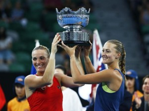 Tennis - Australian Open - Women's Doubles Final - Rod Laver Arena, Melbourne, Australia, January 26, 2018. Hungary's Timea Babos and France's Kristina Mladenovic celebrate winning the Women's Doubles Final with the trophy after winning their match against Russia's Ekaterina Makarova and Elena Vesnina. REUTERS/Edgar Su